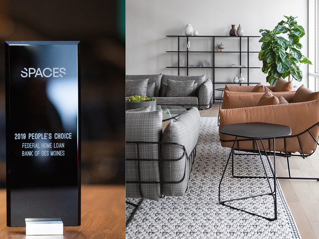 Lounge setting within Federal Home Loan Bank next to 2019 Spaces People's Choice Award.