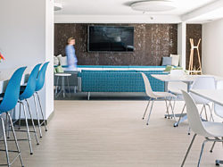 Modern lounge setting with classic furniture, lounge seating, and tables.